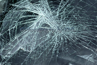 a broken glass windshield on a car