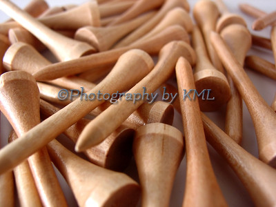 wood golf tees in a pile