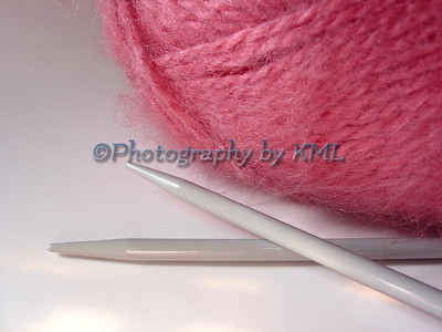 pink yarn and knitting needles showing noise