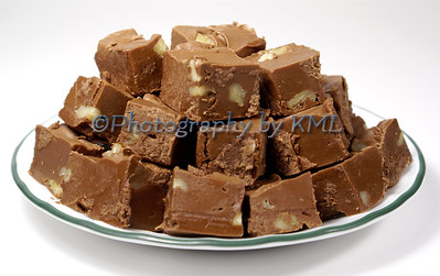 a plate of home made chocolate fudge with nuts