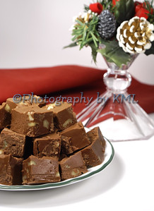 a plate of fudge with a holiday candle holder