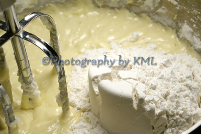 electric mixer with batter and flour