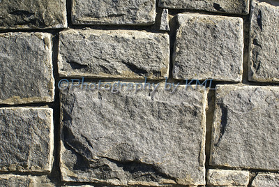 various sizes of granite blocks in a wall