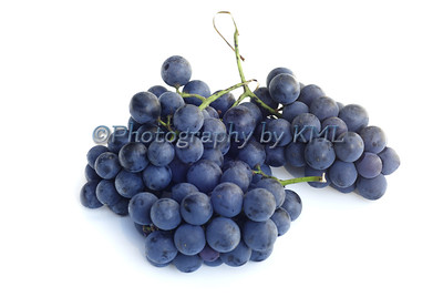 purple grapes against a white background
