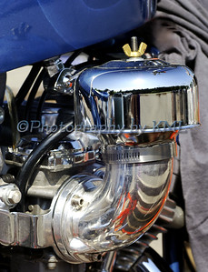 a custom chrome air filter on a motorcycle