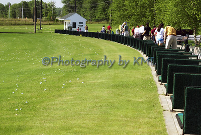 the golf driving range in the summer