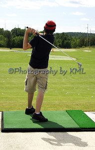 a teen driving golf balls at the driving range