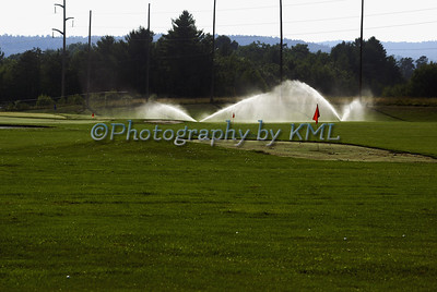 sprinklers on a golf driving range