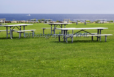 empty picnic tables at the ocean