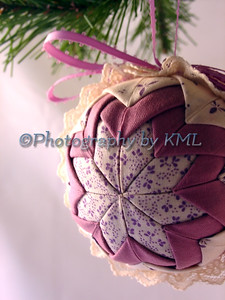 a quilted handmade christmas ornament hanging from the tree