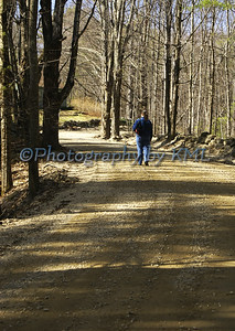 a woman walking on a country road