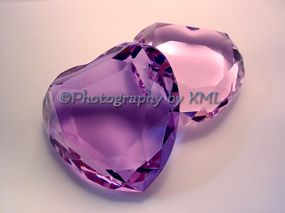 two glass crystal hearts