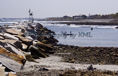 the harbor breaker wall at low tide